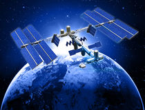 Satellite space station. With earth and sun light  background Royalty Free Stock Photos