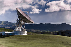 Satellite station with large dish. Satellite Station on farmland, Warkworth, New Zealand Stock Photography