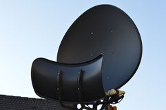 Satellite television. In this picture you see a  black satellite. Picture was taken with a Nikon D3200 Stock Photo