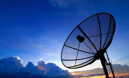 Satellite TV. With sunset sky Royalty Free Stock Photo