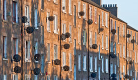 Satellite TV. Brownstone houses covered in satellite dishes in Dundee, Scotland Royalty Free Stock Images