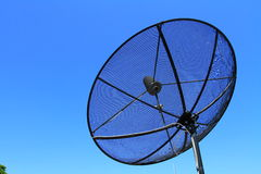 Satellite TV antenna on blue sky background Stock Images