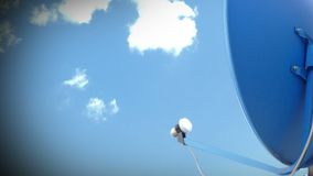 Satellite TV Antenna. With clouds timelapse. Cable TV antenna stock footage