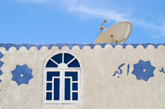 Satellite TV dish on muslim house Stock Photos