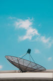 Satellite TV receiver on blue sky Royalty Free Stock Image