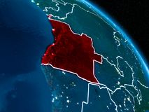 Satellite view of Angola at night. Satellite view of Angola highlighted in red on planet Earth at night with borderlines and city lights. 3D illustration Royalty Free Stock Image