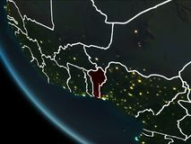Satellite view of Benin at night. Satellite view of Benin highlighted in red on planet Earth at night with borderlines and city lights. 3D illustration. Elements Stock Image