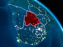 Satellite view of Botswana at night. Satellite view of Botswana highlighted in red on planet Earth at night with borderlines and city lights. 3D illustration Vector Illustration