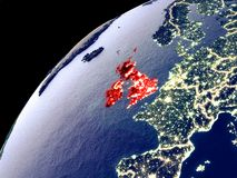 Satellite view of British Isles on Earth. With city lights. Extremely detailed plastic planet surface with real mountains. 3D illustration. Elements of this vector illustration