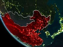Satellite view of China at night. Satellite view of China highlighted in red on planet Earth at night with borderlines and city lights. 3D illustration. Elements Stock Illustration