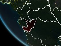 Satellite view of Congo at night. Satellite view of Congo highlighted in red on planet Earth at night with borderlines and city lights. 3D illustration. Elements Royalty Free Illustration