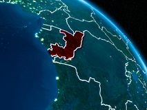Satellite view of Congo at night. Satellite view of Congo highlighted in red on planet Earth at night with borderlines and city lights. 3D illustration Stock Image