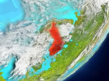 Finland from space. Satellite view of Finland highlighted in red on planet Earth with clouds. 3D illustration. Elements of this image furnished by NASA Royalty Free Stock Image
