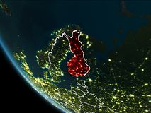 Satellite view of Finland at night. Satellite view of Finland highlighted in red on planet Earth at night with borderlines and city lights. 3D illustration Stock Photos