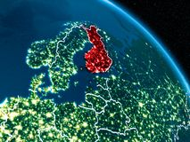 Satellite view of Finland at night. Satellite view of Finland highlighted in red on planet Earth at night with borderlines and city lights. 3D illustration Stock Image