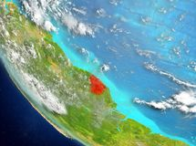 Satellite view of French Guiana in red. French Guiana from orbit of planet Earth with highly detailed surface textures. 3D illustration. Elements of this image Stock Images