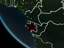 Satellite view of Gabon at night. Satellite view of Gabon highlighted in red on planet Earth at night with borderlines and city lights. 3D illustration. Elements Royalty Free Stock Photos