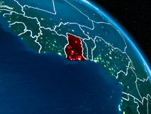 Satellite view of Ghana at night. Satellite view of Ghana highlighted in red on planet Earth at night with borderlines and city lights. 3D illustration Royalty Free Stock Photo