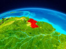 Guyana from orbit. Satellite view of Guyana highlighted in red on planet Earth. 3D illustration. Elements of this image furnished by NASA Royalty Free Stock Image
