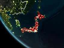 Satellite view of Japan at night. Satellite view of Japan highlighted in red on planet Earth at night with borderlines and city lights. 3D illustration. Elements Royalty Free Stock Photography
