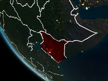 Satellite view of Kenya at night. Satellite view of Kenya highlighted in red on planet Earth at night with borderlines and city lights. 3D illustration. Elements Royalty Free Stock Image