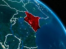 Satellite view of Kenya at night. Satellite view of Kenya highlighted in red on planet Earth at night with borderlines and city lights. 3D illustration Royalty Free Stock Photos