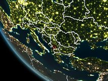 Satellite view of Kosovo at night. Satellite view of Kosovo highlighted in red on planet Earth at night with borderlines and city lights. 3D illustration Vector Illustration