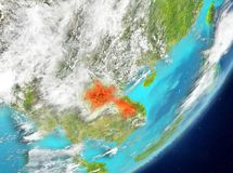 Laos from space. Satellite view of Laos highlighted in red on planet Earth with clouds. 3D illustration. Elements of this image furnished by NASA Stock Photography