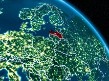 Satellite view of Latvia at night. Satellite view of Latvia highlighted in red on planet Earth at night with borderlines and city lights. 3D illustration Stock Illustration