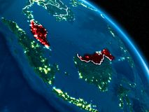 Satellite view of Malaysia at night. Satellite view of Malaysia highlighted in red on planet Earth at night with borderlines and city lights. 3D illustration Royalty Free Illustration