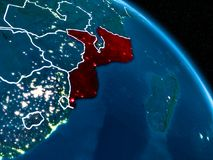 Satellite view of Mozambique at night. Satellite view of Mozambique highlighted in red on planet Earth at night with borderlines and city lights. 3D illustration Royalty Free Illustration