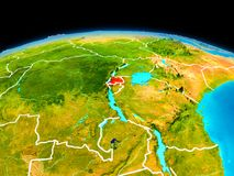 Rwanda in red. Satellite view of Rwanda highlighted in red on planet Earth with borderlines. 3D illustration. Elements of this image furnished by NASA Royalty Free Stock Photography