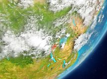 Rwanda from space. Satellite view of Rwanda highlighted in red on planet Earth with clouds. 3D illustration. Elements of this image furnished by NASA Stock Image
