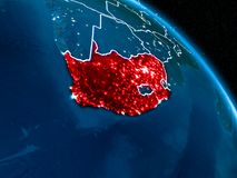 Satellite view of South Africa at night. Satellite view of South Africa highlighted in red on planet Earth at night with borderlines and city lights. 3D Royalty Free Stock Images