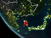 Satellite view of South Korea at night. Satellite view of South Korea highlighted in red on planet Earth at night with borderlines and city lights. 3D Royalty Free Stock Images