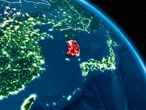 Satellite view of South Korea at night. Satellite view of South Korea highlighted in red on planet Earth at night with borderlines and city lights. 3D Royalty Free Stock Image