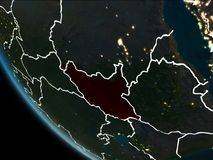 Satellite view of South Sudan at night. Satellite view of South Sudan highlighted in red on planet Earth at night with borderlines and city lights. 3D Stock Images