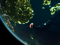 Satellite view of Taiwan at night. Satellite view of Taiwan highlighted in red on planet Earth at night with borderlines and city lights. 3D illustration Royalty Free Illustration