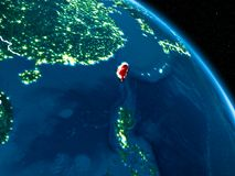 Satellite view of Taiwan at night. Satellite view of Taiwan highlighted in red on planet Earth at night with borderlines and city lights. 3D illustration Royalty Free Stock Image