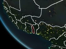 Satellite view of Togo at night. Satellite view of Togo highlighted in red on planet Earth at night with borderlines and city lights. 3D illustration. Elements Stock Image