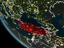 Satellite view of Turkey at night. Satellite view of Turkey highlighted in red on planet Earth at night with borderlines and city lights. 3D illustration Vector Illustration