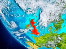 Satellite view of United Kingdom in red. United Kingdom from orbit of planet Earth with highly detailed surface textures. 3D illustration. Elements of this image Royalty Free Stock Photo