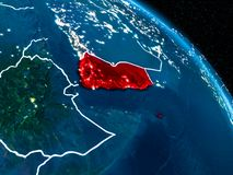 Satellite view of Yemen at night. Satellite view of Yemen highlighted in red on planet Earth at night with borderlines and city lights. 3D illustration. Elements Stock Photo