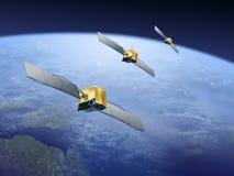 Satelliten über der Erde Lizenzfreies Stockfoto