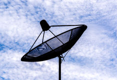 Satellites dish. In the sky with clouds royalty free stock images