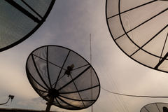 Satellites dish. Sky with Satellite dish and antenna evening royalty free stock photography