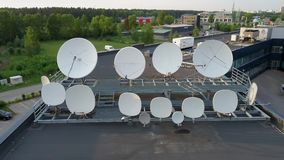 Satellites Dishes Transmitting and Receiving Digital Television Broadcast Signals. Aerial Dron Footage.