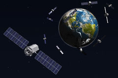 Satellites and earth Royalty Free Stock Photography