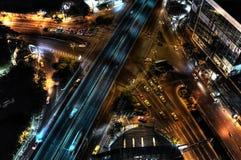 Sathorn crossing, Bangkok. Sathorn crossing at night, cars waiting at the red light by the Belgian bridge Stock Image