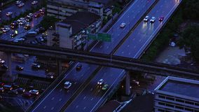 Sathorn road and intersection in transportation concept, BTS skytrain at night, Bangkok, Thailand.  stock video footage